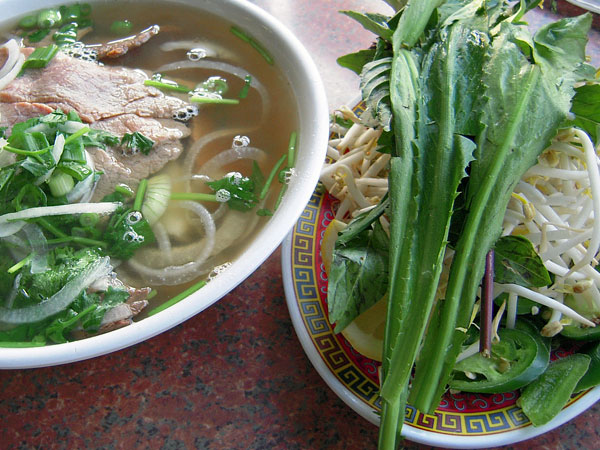 Philippines pho bo and garnish plate